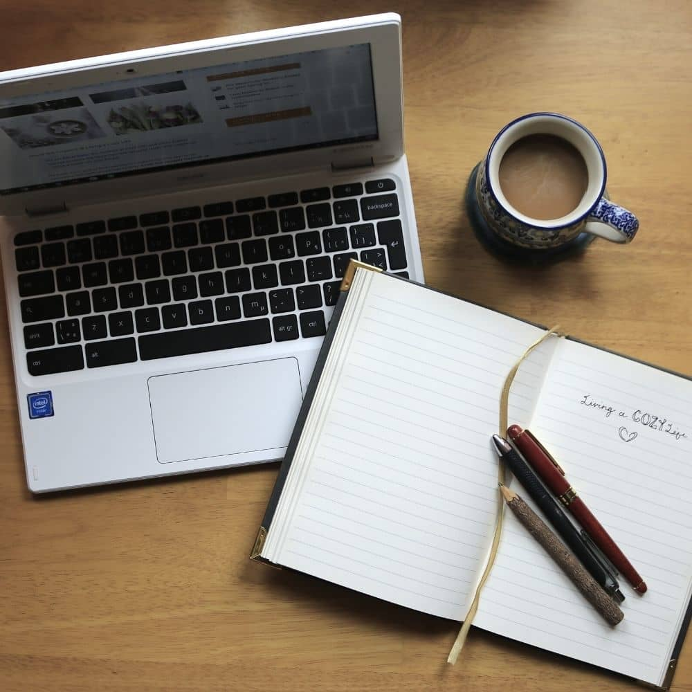 Clean tidy workspace with coffee mug and journal