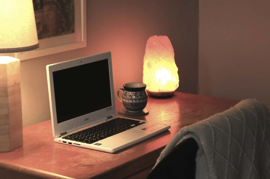 cozy desk space with coffee and laptop