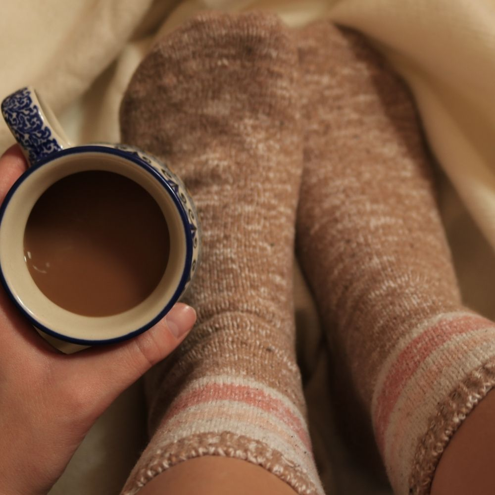 warm cozy socks with a cup of coffee